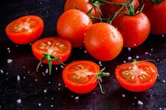 Fresh organic cherry tomatoes with drops and sea salt Royalty Free Stock Photo