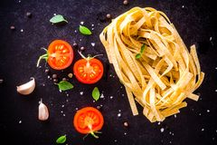 Fresh organic cherry tomatoes and fettuccini with basil and garlic Stock Photography
