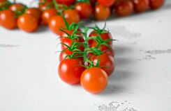 Fresh organic cherry tomatoes on white table stock photo