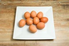 Fresh, organic, chicken eggs on plates Royalty Free Stock Photography