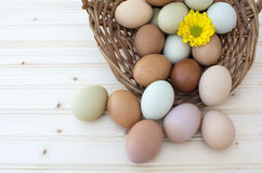 Fresh Organic Chickeneggs In Old Dusty Basket On Wooden Backgrou Stock Photo