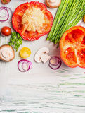 Fresh organic chopped vegetables ingredients on light rustic wooden background, top view Stock Image