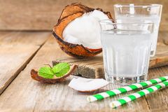 Fresh Organic Coconut Water in a Glass. Food background, selective focus. Fresh Organic Coconut Water in a Glass. Food background, selective focus Stock Photography