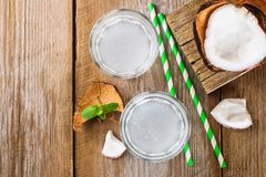 Fresh Organic Coconut Water in a Glass. Food background, selective focus. Fresh Organic Coconut Water in a Glass. Food background, selective focus Stock Images