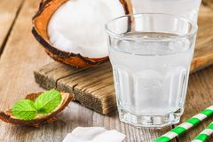 Fresh Organic Coconut Water in a Glass. Food background, selective focus. Fresh Organic Coconut Water in a Glass. Food background, selective focus Stock Image