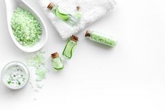 Fresh organic cosmetics with cucumber. Cream, lotion, spa salt on white background top view copyspace. Fresh organic cosmetics with cucumber. Cream, lotion, spa stock images
