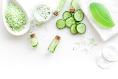 Fresh organic cosmetics with cucumber. Cream, lotion, spa salt on white background top view copyspace. Fresh organic cosmetics with cucumber. Cream, lotion, spa royalty free stock photos