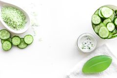 Fresh organic cosmetics with cucumber. Cream, lotion, spa salt on white background top view copyspace. Fresh organic cosmetics with cucumber. Cream, lotion, spa royalty free stock photography
