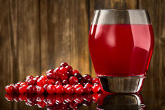 Fresh Organic Cranberry Juice against a wooden Royalty Free Stock Images