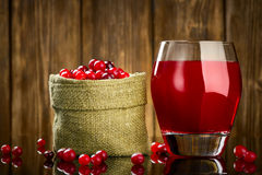 Fresh Organic Cranberry Juice against a wooden stock photos