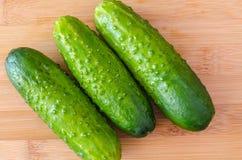 Fresh organic cucumbers. On light background Stock Images