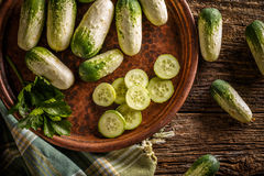 Fresh organic cucumbers. On rustic style background Stock Image