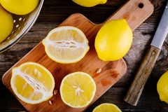 Fresh organic cut lemons on a wooden background. Top view royalty free stock photography