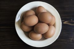 Fresh organic eggs on wooden table. Close up Royalty Free Stock Images