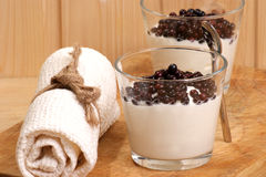 fresh organic elderberries and yoghurt in a glass Stock Image