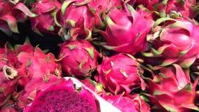 Fresh organic exotic fruit - dragon fruit in the supermarket. Farm food in Asia, Indonesia. Fresh organic exotic fruit - dragon fruit in the supermarket. Farm stock footage