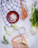 Fresh organic fennel bulbs for culinary purposes on wooden backg Stock Image
