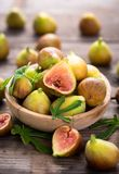Fresh organic figs. On the wooden table Royalty Free Stock Photography