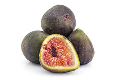 Fresh organic figs. Pile of fresh ripe organic figs, one cutted in half, isolated on white background Stock Image
