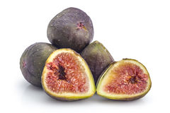 Fresh organic figs. Pile of fresh ripe organic figs, one cutted in half, isolated on white background Royalty Free Stock Photography