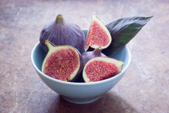 Fresh organic figs. Fresh ripe organic figs on brown background Stock Photos