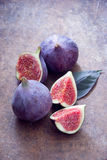 Fresh organic figs. Fresh ripe organic figs on brown background Royalty Free Stock Photo
