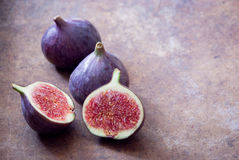 Fresh organic figs. Fresh ripe organic figs on brown background Royalty Free Stock Photography