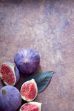 Fresh organic figs. Fresh ripe organic figs on brown background Stock Image