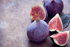 Fresh organic figs. Fresh ripe organic figs on brown background Royalty Free Stock Images