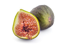Fresh organic figs. Two fresh ripe organic figs, one cutted in half, isolated on white background Stock Photography
