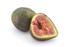 Fresh organic figs. Two fresh ripe organic figs, one cutted in half, isolated on white background Stock Images