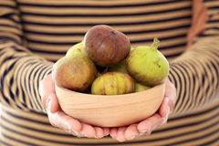 Fresh organic figs in wooden bowl Royalty Free Stock Image