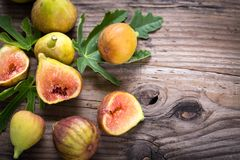 Fresh organic figs. On the wooden table Royalty Free Stock Photos