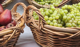 Fresh organic fruit in baskets at market Royalty Free Stock Images
