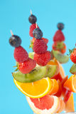 Fresh organic fruit kebabs. Against a plain background - shallow dof stock photo