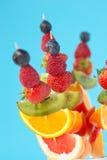 Fresh organic fruit kebabs. Against a plain background - shallow dof Stock Photo