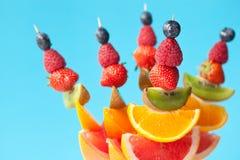 Fresh organic fruit kebabs stock photography