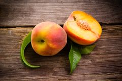 Fresh organic fruit - peaches on wood Stock Image