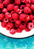 Fresh organic fruit - raspberry on wood background selective focus Royalty Free Stock Photo