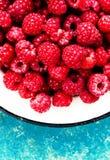Fresh organic fruit - raspberry on wood background selective focus Royalty Free Stock Photo