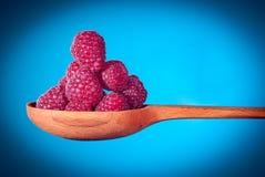 Fresh organic fruit - raspberry on wooden spoon Stock Photography
