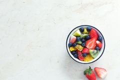 Fresh organic fruit salad with chia seeds. Top view Royalty Free Stock Image
