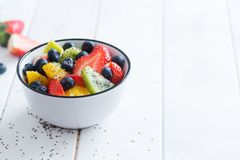 Fresh organic fruit salad with chia seeds Royalty Free Stock Images