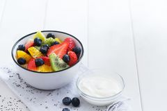 Fresh organic fruit salad with chia seeds and yogurt Stock Photography