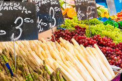 Fresh organic fruit and vegetables at farmers market stall Stock Photos