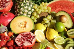 Fresh organic fruit and vegetables. Fresh tropical fruits on a wooden table Stock Photo