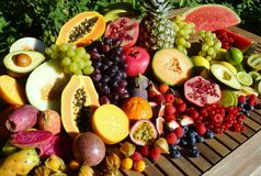 Fresh organic fruit and vegetables. Fresh tropical fruits on a wooden table Royalty Free Stock Photo