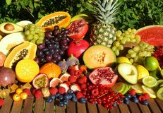 Fresh organic fruit and vegetables. Fresh tropical fruits on a wooden table Stock Image