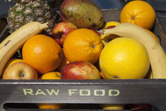 Fresh organic fruit in wooden box Stock Photography