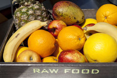 Fresh organic fruit in wooden box Stock Photos